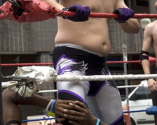 Kelli Cardinal/The Vindicator Lou Lindstrom, top, keeps a hold Sunday on competitor Chase Aaryons (ok), both from Highstakes Battleground Wrestling, during a triple threat match at the Spanish Heritage Festival in downtown Youngstown.