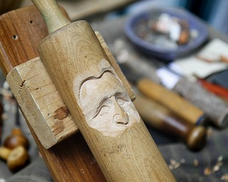 MADELYN P. HASTINGS | THE VINDICATOR  A face is carved into a rolling pin by wood carver Delaine Gerstbauer at the Shaker Woods Festival in Columbiana on Sunday, August 18, 2013.