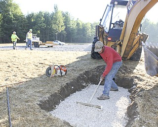 Workers with Miller-Yount Paving of Bazetta, including Curtis Jones  