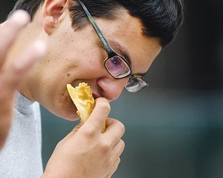 Antonio Montanez of Campbell eats a pastelillos de carne or meat pie on Sunday during the Spanish Heritage Festival.