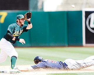 Indians baserunner Jason Kipnis, right, steals second base as Athletics second baseman Eric Sogard awaits the throw during Sunday's game in Oakland, Calif. The Athletics won, 7-3.