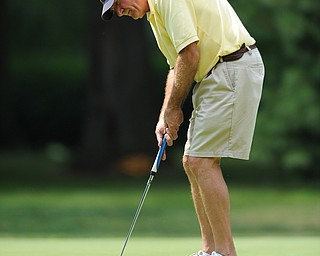 Ray Vershun of Canfield follows through on his putt on the 12th hole Tuesday afternoon at the Trumbull Country club.