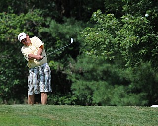 Dave Beitz of Poland tees off on the 12th hole Tuesday afternoon at the Trumbull Country club.