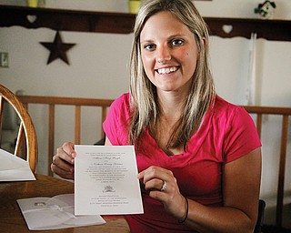 Alissa Boyle of Salem shows her wedding invitation. She hopes to walk down the aisle to her husband-to-be, Nathan Grimes, on Sept. 7.