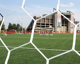 The Youngstown State women's soccer team practices for the first time Wednesday on the Farmers National Bank Field on the YSU campus. For the first time in the school's history, the Penguins have a team capable of being bigger than its new field.