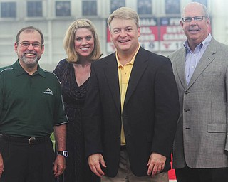 Spreading awareness about the 2013 Youngstown Area Heart Walk are, from left, T.J. Meister from WBBG; Allison Oltmann, Heart Walk director; Dave Sess, from WKBN-TV 27; and Doug Sweeney, chairman of the Heart Walk. The walk will take place Sept. 21 at the WATTS at Youngstown State University and has a fundraising goal of $250,000. NANCY URCHAK | SPECIAL TO THE VINDICATOR