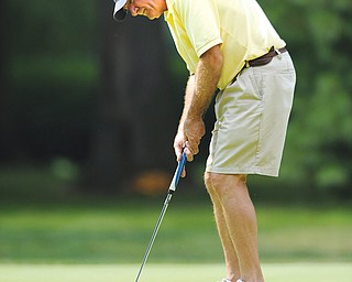 Ray Vershum of Canfield follows through on his putt on the 12th hole Tuesday afternoon at the Trumbull