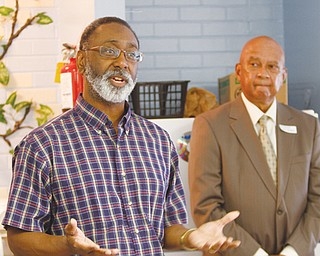 Ernie Brown, regional editor and columnist for The Vindicator, tells of his days in high school and college at the Plaza View housing complex. Thursday was career day for high school students who live there. In the background is Dr. James Hovell, a dentist and moderator for the event.