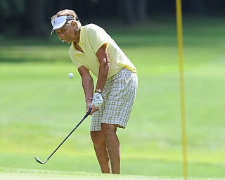 Golfer Marilyn Woods of Hubbard chips her ball from the fairway to the green on the 18th hole on the south course course Friday afternoon at Mill Creek Golf Corse part of the Vindy Greatest Golfer on August 23, 2013.