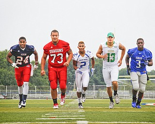 MADELYN P. HASTINGS | THE VINDICATOR..(L-R) Darrin Hall from Fitch, Josh Krok from Niles, Darien Townsend from Youngstown Christian, Chris Durkin from Ursuline, and L.J. Scott from Hubbard, pose for a portrait at the Fitch Stadium on Saturday, July 27.... - -30-..
