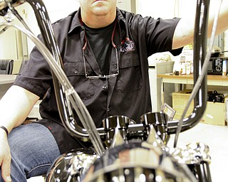 William D. Lewis\The Vindicator Dave Cook, owner of Sledgehammer Bobbers, poses with a custom motorcycle he built. His business is building an Evil Knievel tribute motorcycle.William D. Lewis\The Vindicator.