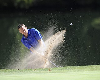 Golfer Eddie Maughan Jr. chips out of the sand trap on the 9th hole Saturday afternoon at Youngstown Country Club as part of the Vindy Greatest Golfer tournament on August 24.
