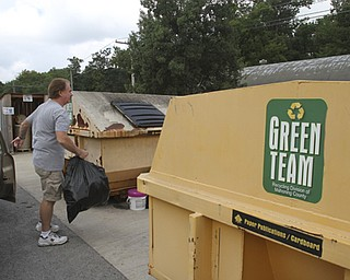 William D Lewis the Vindicator Rich Jones of Poland deposits plastic items at Poland recylcing center 8-19-13