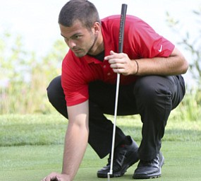 William D LEwis the Vindicator Griffin Todd lines up a putt during ggov sunday.