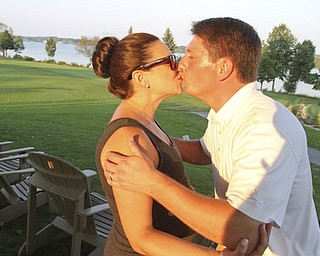 William d Lewis the Vindicator GGOV open winner Jonah Karzmergets a kiss from his wife Beth Karzmer after winning Sunday at the Lake Club.