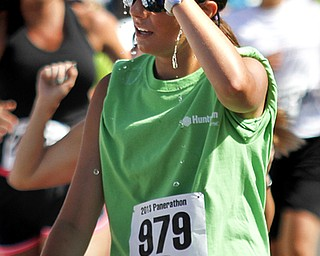MADELYN P. HASTINGS | THE VINDICATOR..*** pours water on her head after completing her race in the Panerathon held at the Covelli Centre on August 25, 2013. The Panerathon is the largest community fundraising event in the Youngstown area that benefits the Joanie Abdu Comprehensive Breast Care Center.... - -30-..