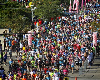 MADELYN P. HASTINGS | THE VINDICATOR..Runners begin their races during the fourth annual Panerathon held at the Covelli Centre on August 25, 2013. The Panerathon is the largest community fundraising event in the Youngstown area that benefits the Joanie Abdu Comprehensive Breast Care Center.... - -30-..