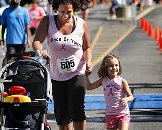 MADELYN P. HASTINGS | THE VINDICATOR..Chrisy Davis  and her daughter Gabriella, 3, of Austintown react after finishing their race together during the Panerathon held at the Covelli Centre on August 25, 2013. The Panerathon is the largest community fundraising event in the Youngstown area that benefits the Joanie Abdu Comprehensive Breast Care Center.... - -30-..