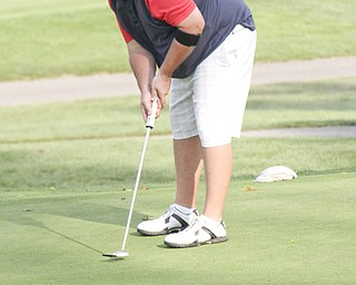 Michael Guerreri smiles as his putt is online of the eighth hole of The Lake Club in Poland during rhe Greatest Golfer of the Valley tournament on Sunday.  Dustin Livesay  |  The Vindicator  8/25/13  Poland.