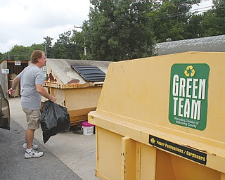 Rich Jones of Poland deposits plastic items at Poland Township's recycling site, 7474 Clingan Road.