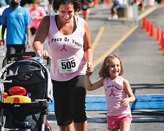 Chrisy Davis and her daughter Gabriella, 3, of Austintown finish their benefit walk together.