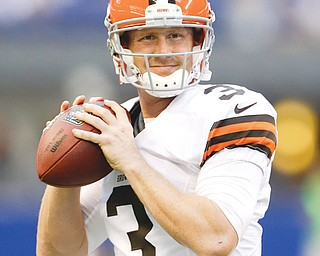 Cleveland Browns quarterback Brandon Weeden throws before Saturday night's game against the Indianapolis Colts at Lucas Oil Stadium in Indianapolis. The Colts beat the Browns, 27-6, but Weeden says he's not worried.