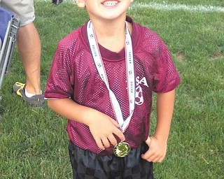 Jimmy Lipjanic, 5, of Boardman, who played on a Boardman soccer team, shows his excitement at the end of the season. Sent by parents Jim and Candace Lipjanic.