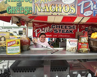 Margie Brady of the Original Philly Cheese Steak gets her concession stand ready for the opening of the 167th