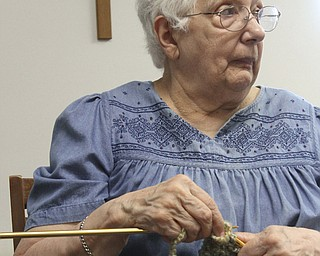 Lucille Stewart of Canfield participates in the Ursuline Sisters' Prayer Shawl Ministry. Since the group's formation in 2008, more than 700 handmade prayer shawls stitched by 30-odd members have been distributed to the Ursuline Sisters' HIV/AIDS Ministry and the Hope Cancer Center, among other organizations.