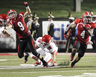 William D Lewis The Vindicator  YSU's Andre Stubbs(4) scampers for yardage during 1rst half action against Dayton Thursday 8-28-13.Blocking for ysu is Michael Wheary(9). Defending for Dayton are Kyle Sebetic(24) and Sean Sward(19).