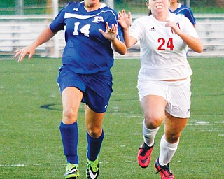 Canfield's Marissa Severino (24) steals the ball from Poland's Phoebe Bush (14) during their soccer match Wednesday at Canfield High School. The Cardinals routed the Bulldogs, 10-0.