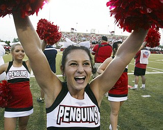 William D Lewis  The Vindicator  YSU cheerleader Sarah Perry  shows her team spirit during YSU opener Thursday with Dayton.