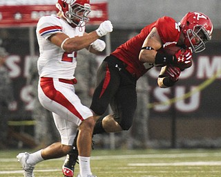 William D Lewis The Vindicator  YSU's Christian Bryan(2) pulls in a pass past Dayton's Zach Elias(27)during 1rst half action against Dayton Thursday 8-28-13.