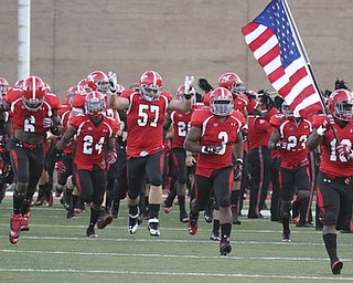 William D LEwis  YSU Adaris Bellamy (13) leads the Penguins onto the field for Thursday opener with Dayton.