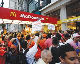 Protesting fast-food workers demonstrate outside a McDonald's restaurant on New York's Fifth Avenue on Thursday. Thousands of fast-food workers staged walkouts in dozens of cities around the country Thursday,