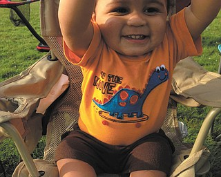 11-month-old TJ Pixley rooted for his big brother, Joel Cuevas, during a Flag Football game this summer. Sent by Betty Cuevas of Boardman, their grandmother.