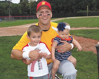 Jim Putko of Boardman with his son Jimmy, 4, and daughter Julia, 8 months, who cheered for their daddy through his final baseball game of the year. Sent by Casey Putko.