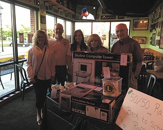 At the Quaker Steak & Lube National Chicken Wing Day and raffle, the Youngstown Lions Club earned $510. The money will be used to buy backpacks for Youngstown City School students. The Lions will add $200 for school supplies to fill the backpacks. Some of the Lions members involved, from left, are Nancy Cuffle of Poland, King Lion; Pete Storey of Austintown; Michele Ballone of Lowellville; Josie Polis of Poland; and Bill Cooper of Austintown. Photo: Special to The Vindicator