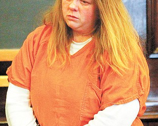 Shain Widdersheim waits Wednesday to hear her sentence from Judge R. Scott Krichbaum after she pleaded guilty to charges she failed to protect her three sons from abuse from her ex-boyfriend.