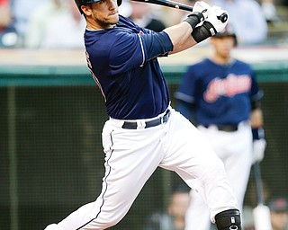 Cleveland Indians' Yan Gomes hits an RBI-single off Baltimore Orioles starting pitcher Zach Britton in the first inning of a game Wednesday in Cleveland.