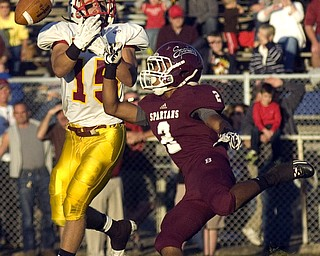 Kelli Cardinal/The Vindicator.Cardinal Mooney strong safety Denver Martin misses the catch Friday night against Boardman defender Turel Thompson at Boardman.