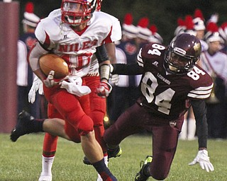 William D. Lewis The Vindicator  Niles' Chris Parry(10) eludes Liberty's Darryl McCullough (84)during 2nd qtr action at Liberty 9-6-13.