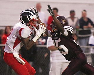 William DLewis The Vindicator  Niles Marcus Hll 2) pulls in a pass while Liberty (25)Khyri Davis defends during 2nd qtr action at Liberty 9-6-13.