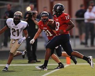 Fitch #18 Antwan Harris crosses the goal line to score a touchdown during the first half of a game on Friday September 6, 2013. Fitch #81 Austin Hogan and Hoban #21 Tyler Gilchrist pictured.
