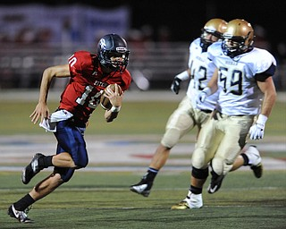 Fitch #10 Gabe Chepke cuts back across the field for extra yardage after breaking to the open and getting pat Hoban #59 Tristian Roothenbuecher and #42 Travis Pero. He would score on the play during the first half of a game on Friday September 6, 2013.
