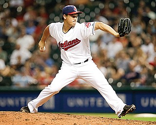 Cleveland Indians relief pitcher Chen-Chang Lee delivers a pitch in the eighth inning of a game against the Kansas City Royals in Cleveland on Tuesday.