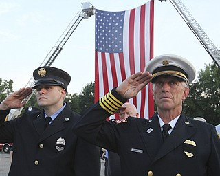 William D. Lewis The Vindicator  Ellsworth twp firefighter Jeremy Hartman, left, and Ellsworth FD Chief Sherman Yeager during 9-11 ceremony in Austintown Wed.