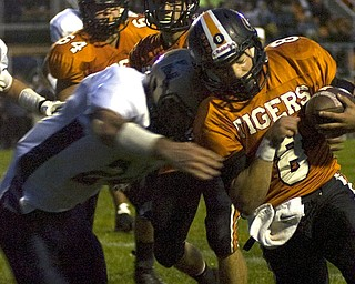 Kelli Cardinal/The Vindicator .Springfield quarterback Hunter Snyder is brought down Friday night by a Lowellville defender in the second quarter at Springfield High School.