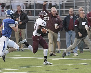 ROBERT  K. YOSAY | THE VINDICATOR..Boardmans #23 Dawan Britt breaks for the Endzone as the sidelines cheered Polnas #4 Dylan Garver in pursuit . .He was stopped yards before the TD.Boardman Spartans at Poland Bulldogs Stadium