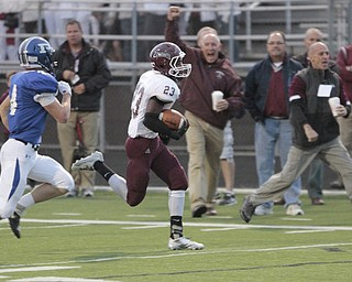 .          ROBERT  K. YOSAY | THE VINDICATOR..Boardmans #23 Dawan Britt breaks for the Endzone as the sidelines cheered Polnas #4 Dylan Garver in pursuit . .He was stopped yards before the TD.Boardman Spartans at Poland Bulldogs Stadium
